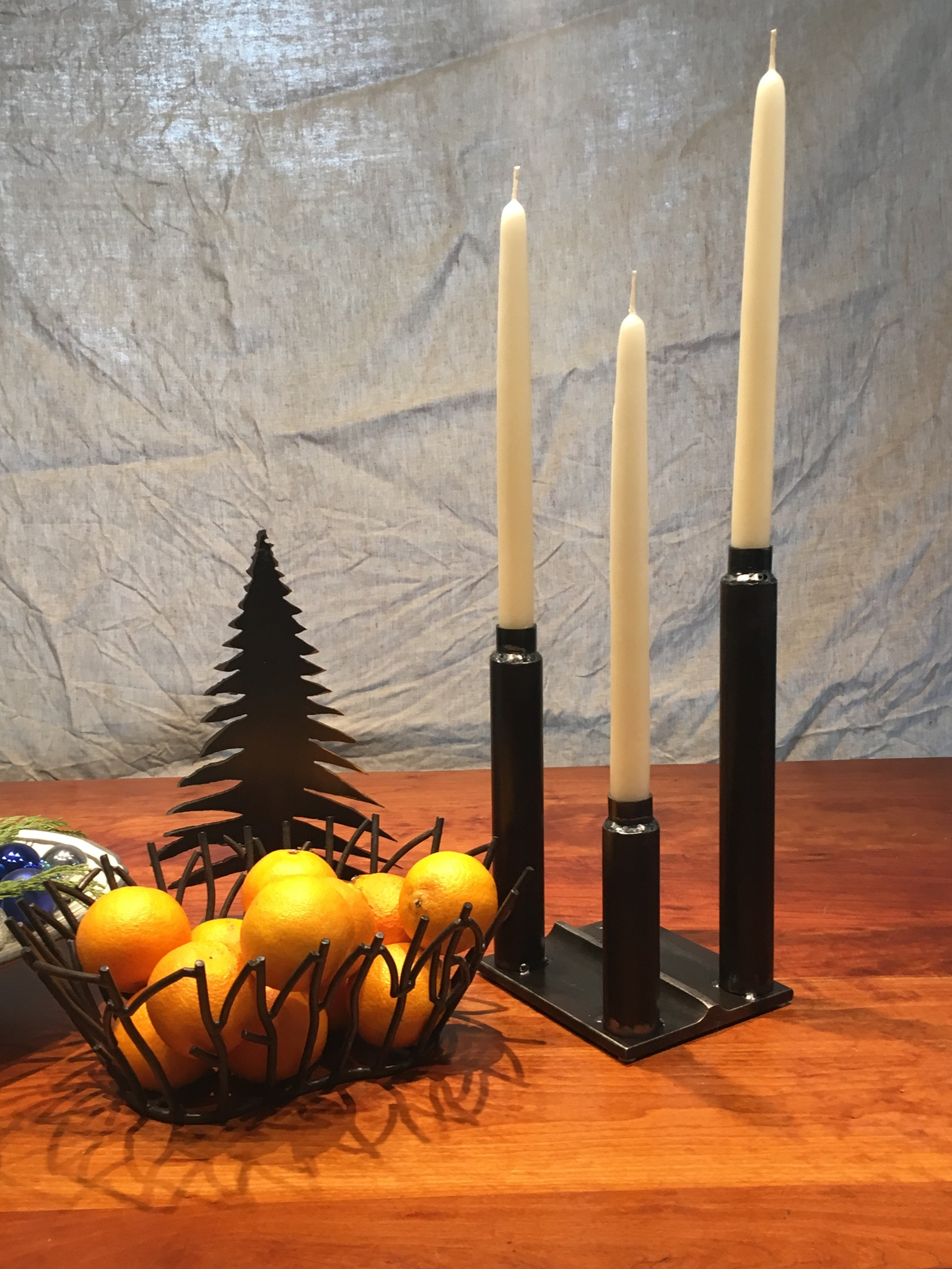 Industrial welded black steel pipe candle holders